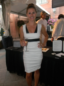 Brittany Pollock, buyer for O2 looking very Italian glam in Nicole Miller and upswept bun.