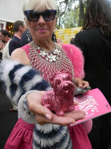 Shari Applebaum in Valentino and 'adapted' pet pink puppy purse by artist Jeff Koons.