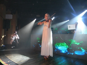 The Dolls, with DJ Mia Moretti and violinist Margot, performing at after-party at Belly Up.